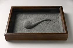 Une pipe de cendres