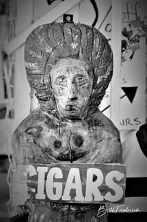 a cigar store indian with sign.jpg