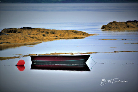 a boat in nova scotia with sign.jpg