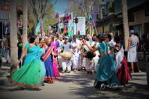 a dancing krishnas with sign.jpg