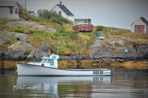 a canadian lobster boat with sign.jpg