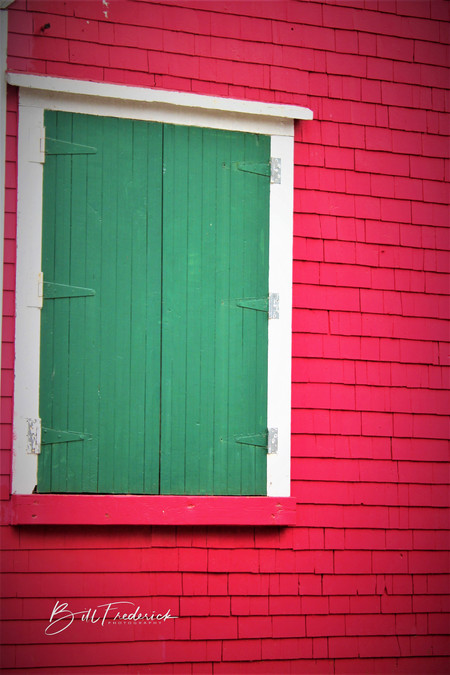 red wall green door with sign - Copy.jpg