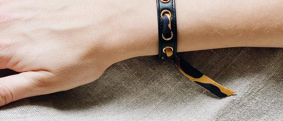 Bracelet noir Cycle, ruban Léopard moutarde