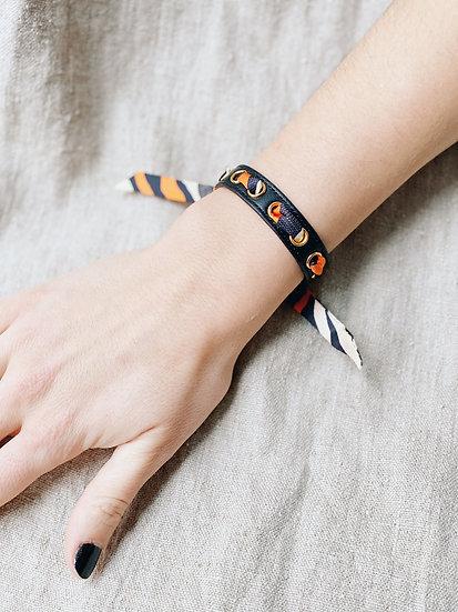 Bracelet noir Cycle, ruban Le Zèbre orange