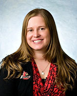 Professional photo Dr. Brooke with hair down, red shirt and black suit. Louisville Lapel Pin