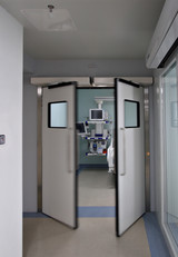 Automatic P50 panelled double swing doors
