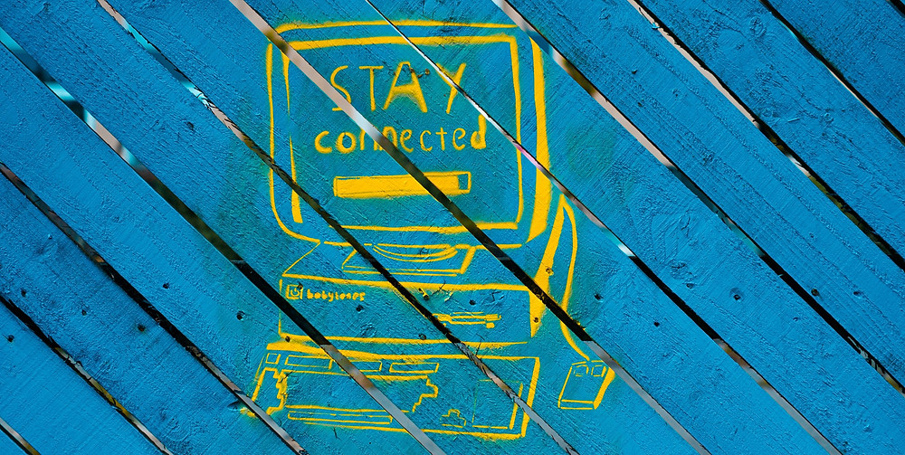 Stay connected, blue wooden board with yellow markings and quote on remote work