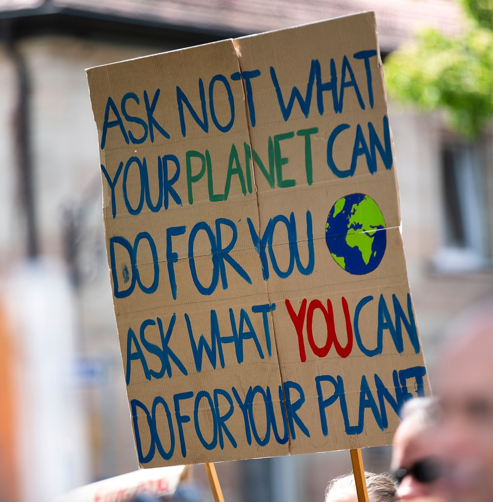 Writing on cardboard for planet protest