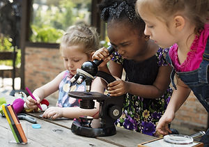 Little Girls Using Microscope Learning S