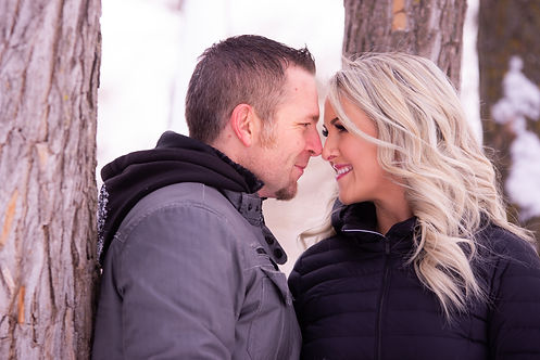 Couple rubbing noses to stay warm.