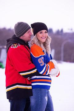 Flames and Oilers hug and smile.