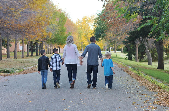 Our blended family of 5 walking together.