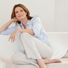 Mature-woman-in-thoughts-on-sofa-1381614