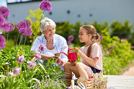 Picture of older lady with female child in a garden