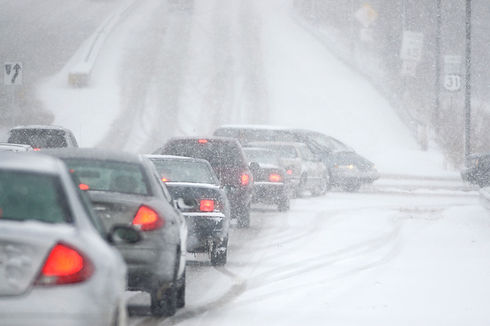 Line of cars in snow storm