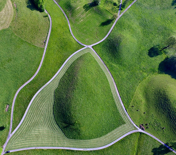 Aerial view of curved roads through fields
