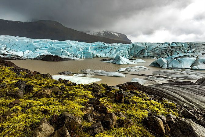 Svinafellsjokull Glacier in Iceland with moss clouds and ice