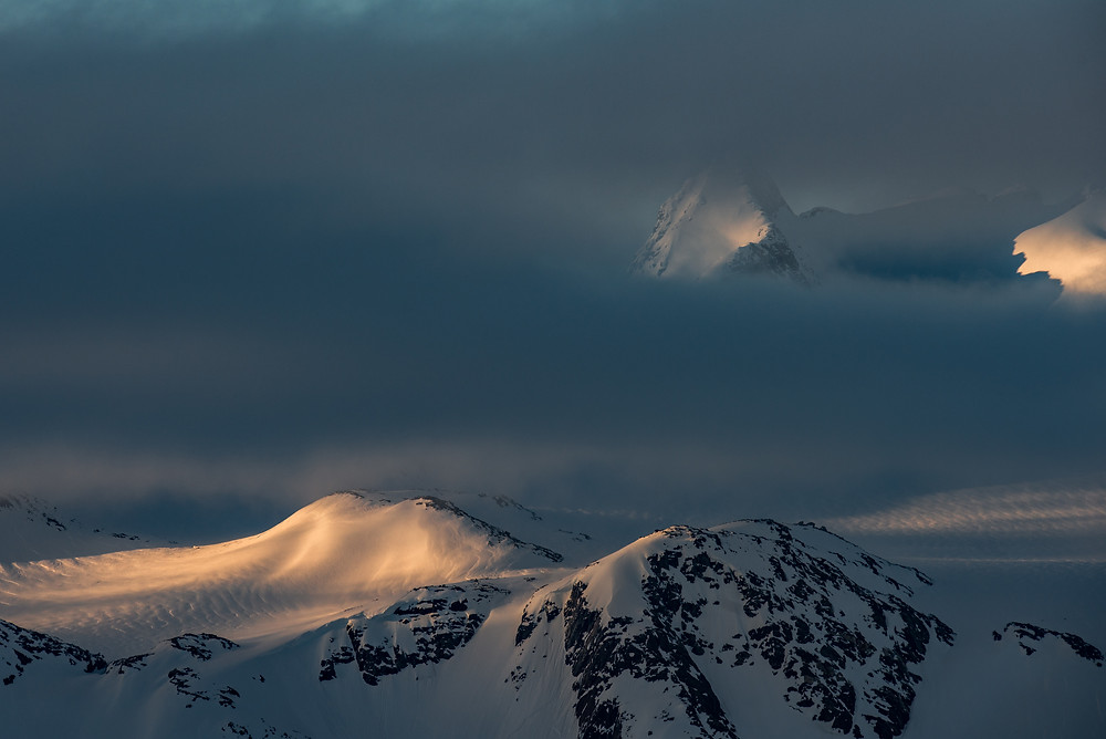 Greenland mountains shrouded in clouds