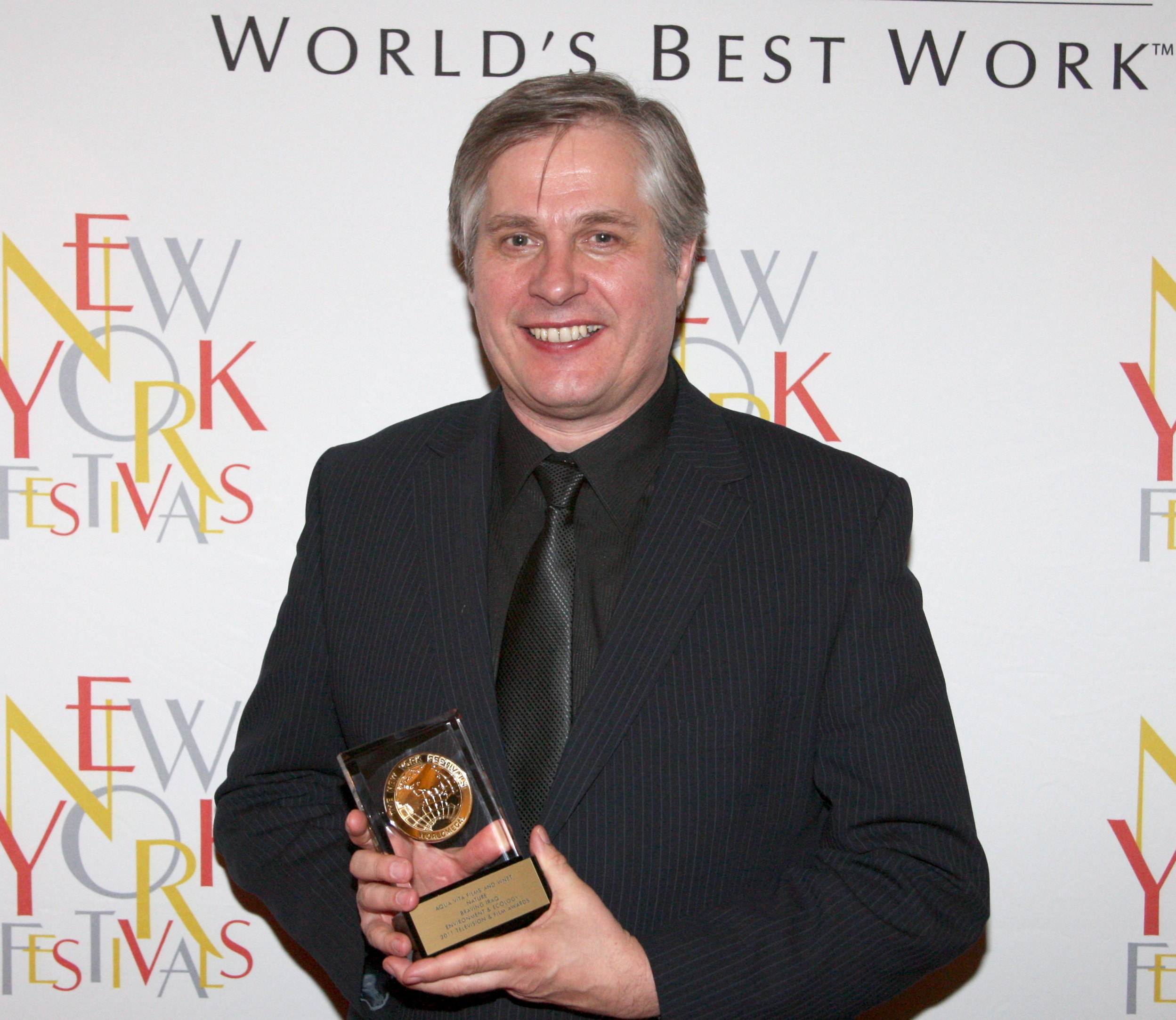 Bernard with NY award.jpg