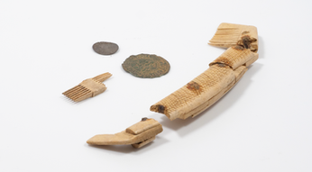 Bone comb and coins