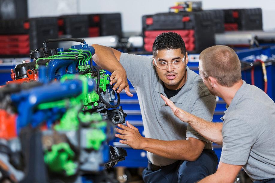 Two-multi-racial-men-in-auto-mechanic-sc