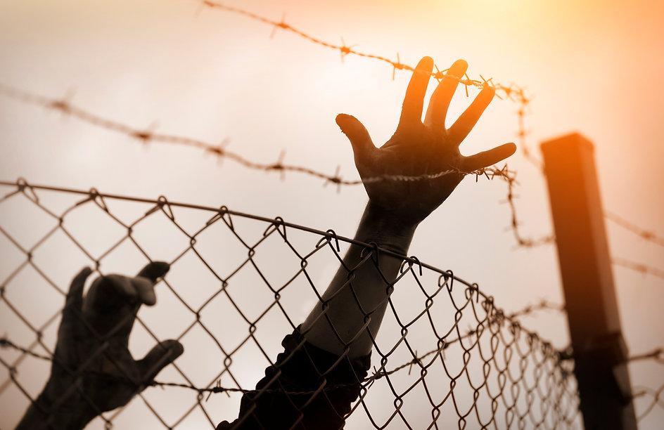 Refugee-men-and-fence.-Refugee-concept-5