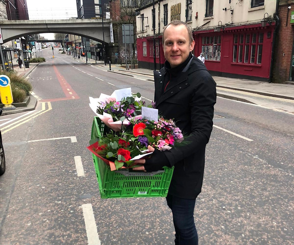 Our florist team delivering flowers to Manchester