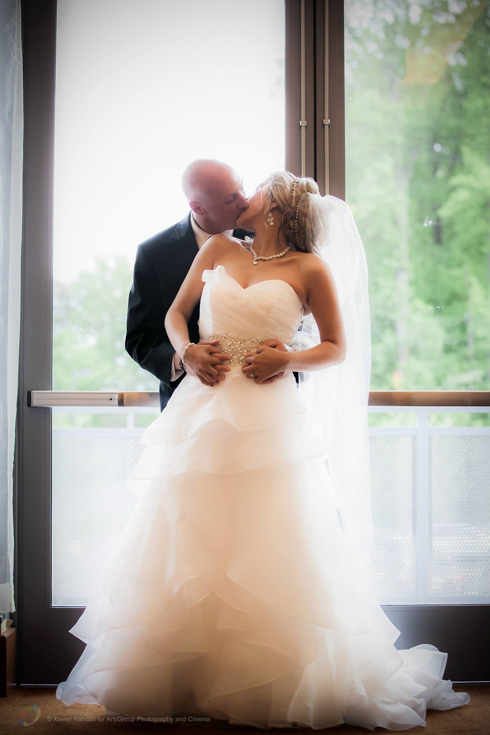 An image of a bride and groom kissing on their wedding day.