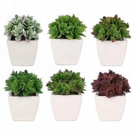 Artificial plant in white pot