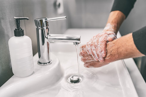 Washing hands rubbing with soap man for