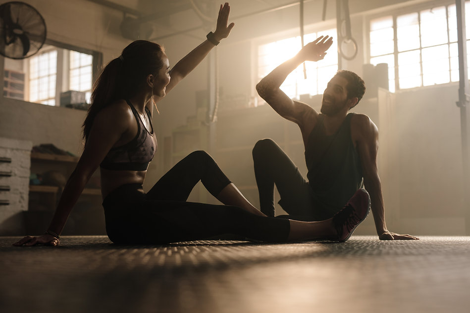 Fitness man and woman giving each other