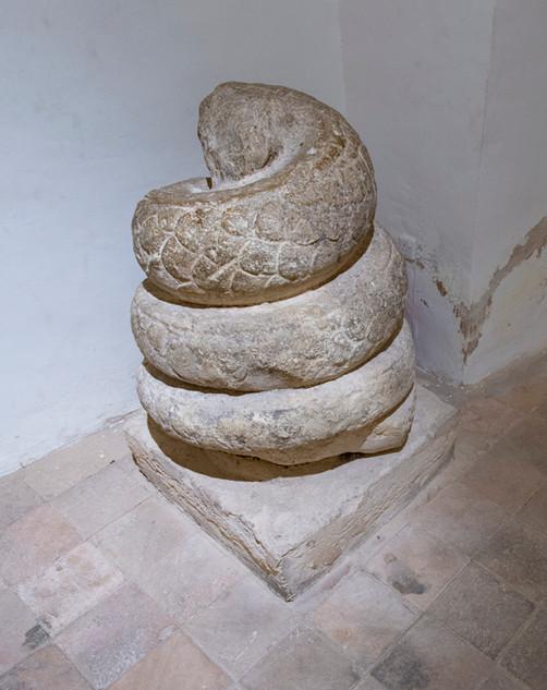 Snake carved in limestone