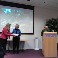 Judy Code accepting the Priley Award from MSHS
