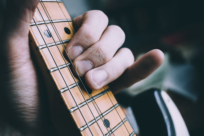 photo-of-person-playing-the-guitar-10294