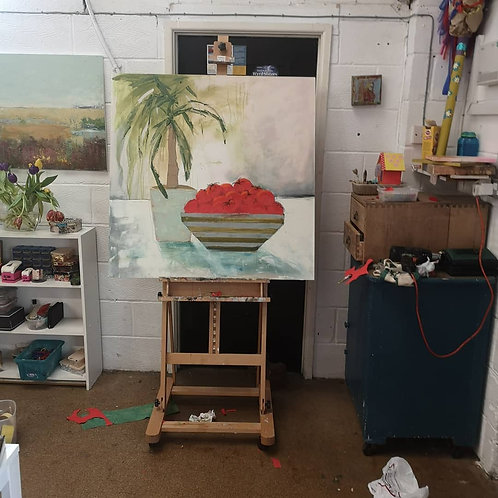 Some tomatoes and a yucca plant