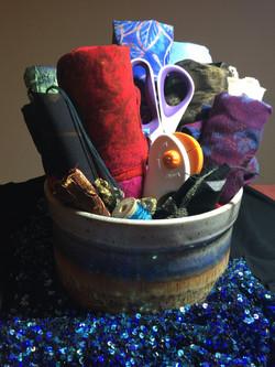 Rolls of fabric in ceramic pot