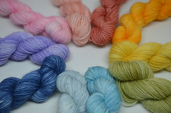 Rainbow mini yarn skeins by HennyPennyMakes