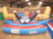Inflatable Gladiator Game with Deluxe Roman artwork with Themed backwall and Inflated podiums