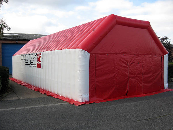 Red and White Inflatable Worktent with horizontal beam roof