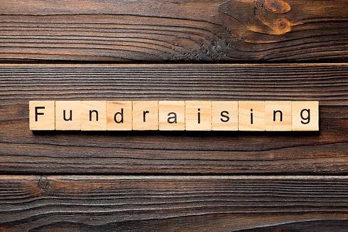 fundraising word written on wood block.