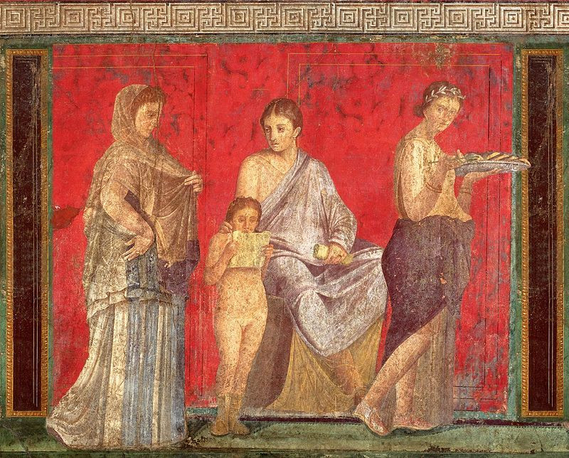 The first fresco depicting three women and a boy reading a scroll in the Villa of the Mysteries