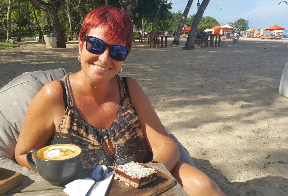 Woman in Bali having lunch at the beach
