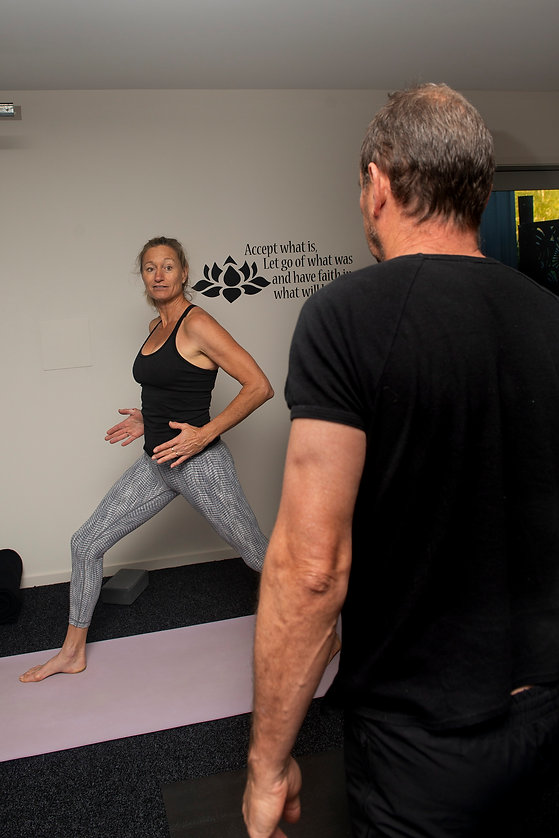 Michelle Triggs instructing yoga client