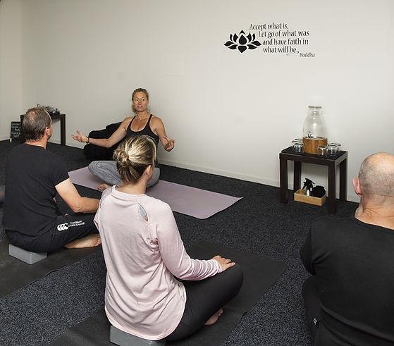 Michelle Triggs instructing yoga class