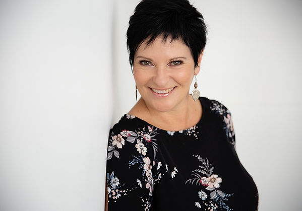 Woman with short dark hair and floral top