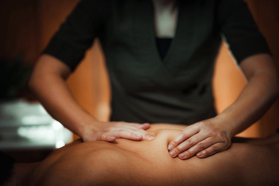 Therapist massaging client
