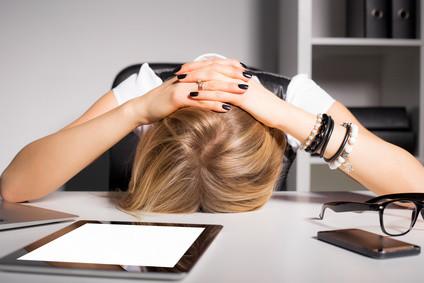 Overwhelmed Business Woman.jpg