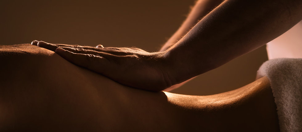 Massage closeup with hands of profession