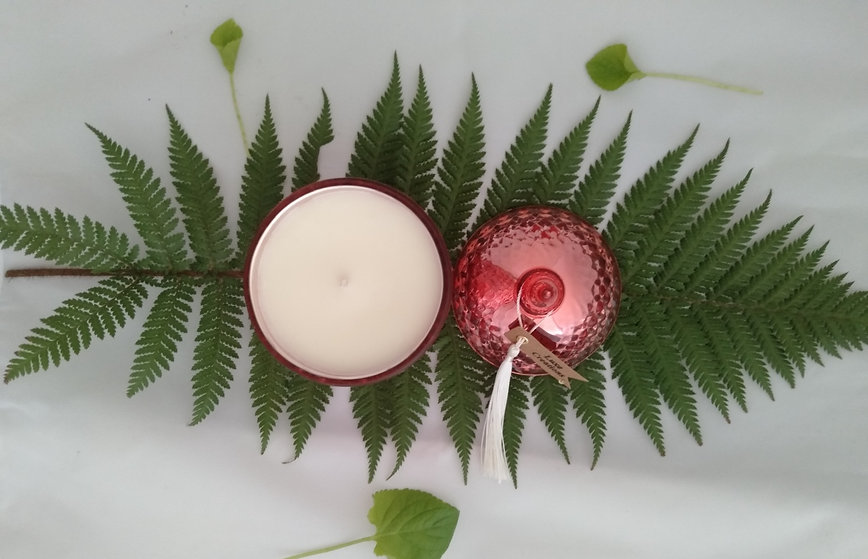Luxe Creations Candle on fern