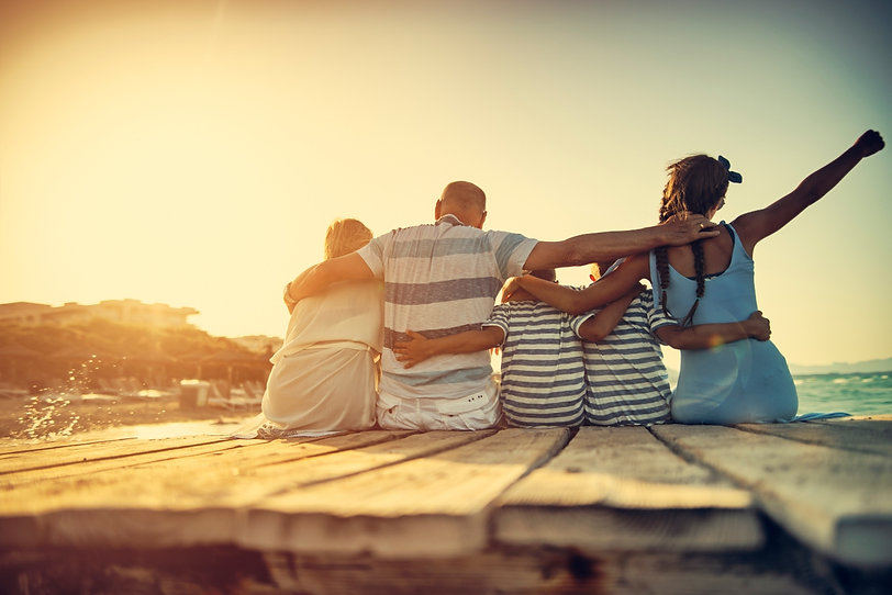 Happy Family sitting on a dock